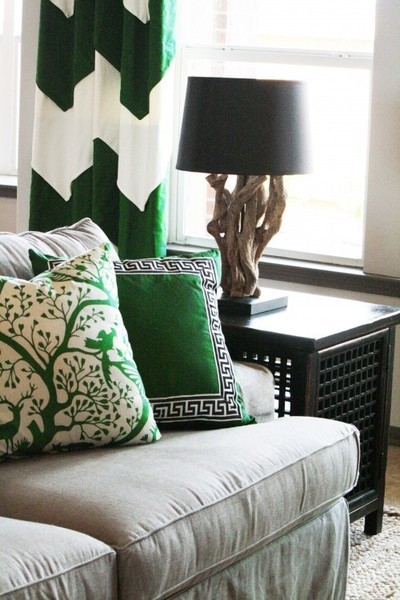 Green accents in pillows and curtains