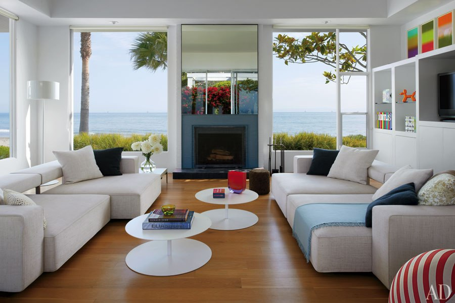 Large windows with white decor and colorful art