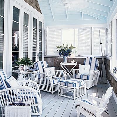 Blue and white enclosed porch