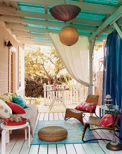 Porch with rug and pillows
