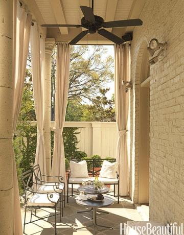 Neutral curtains on porch